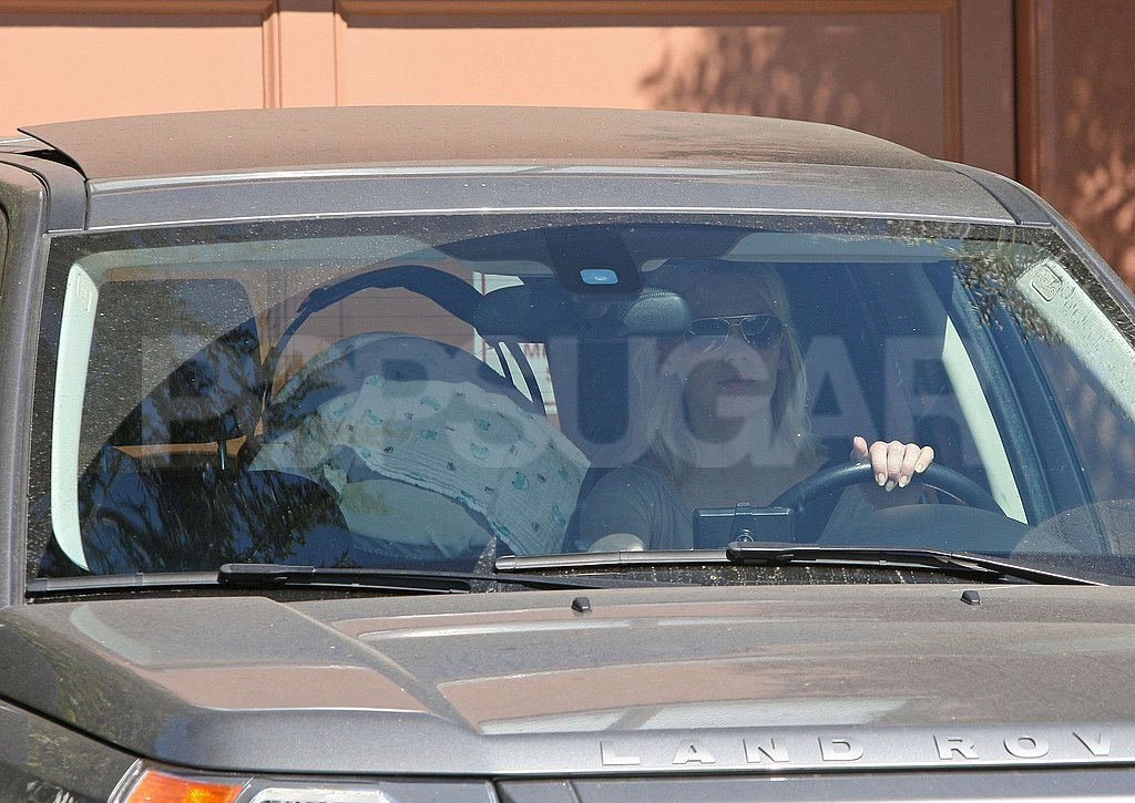 January Jones pulled out of a driveway with Xander Jones.