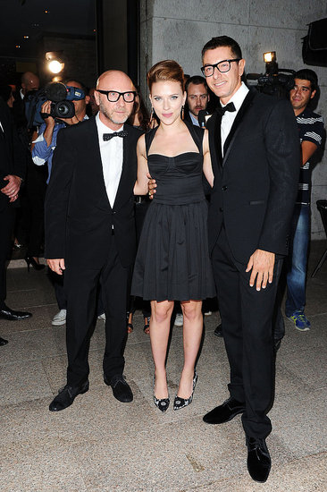 Scarlett Johansson parties with Dolce & Gabbana designers Domenico Dolce and Stefano Gabbana at Milan Fashion Week on Sept. 25.