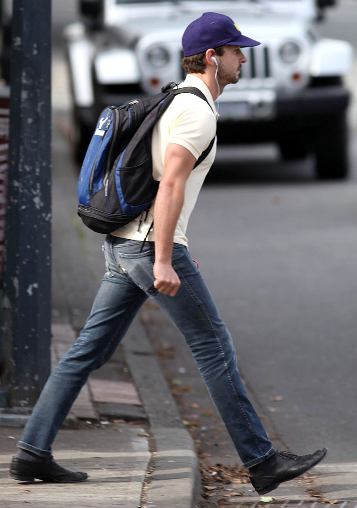 Shia LaBeouf carried his books in a blue backpack.