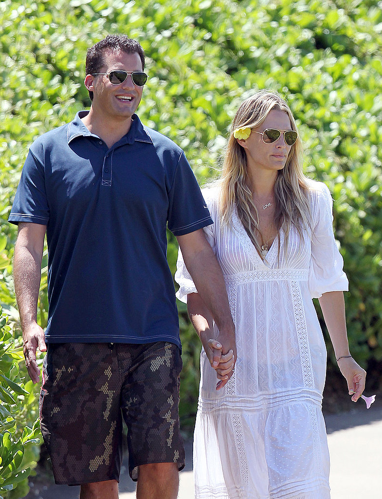 Molly Sims wears a bikini and cover-up with husband Scott Stuber.