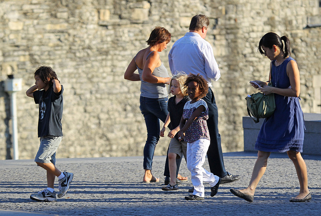 Pax, Shiloh, and Zahara at the Tower of London with a nanny.
