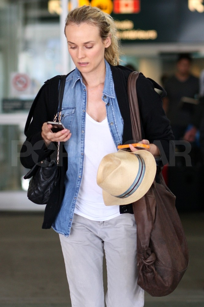 Diane Kruger checks her cell phone once she's arrived in Canada.