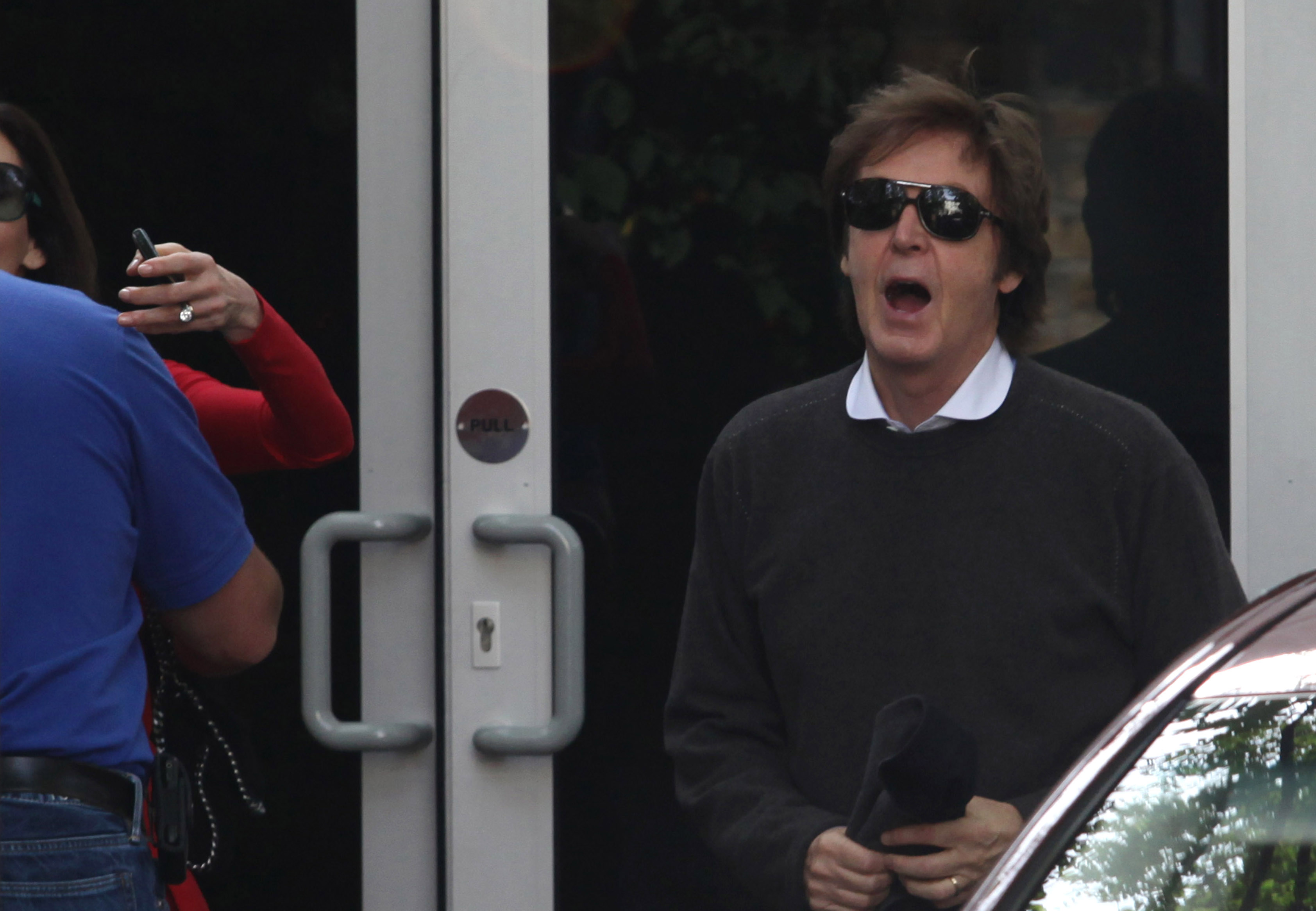 Paul McCartney leaves for his honeymoon with Nancy Shevell.