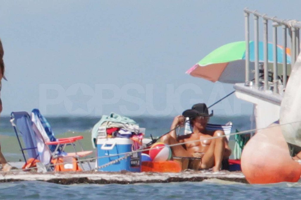 Matthew McConaughey lounged on the beach in a cowboy hat.