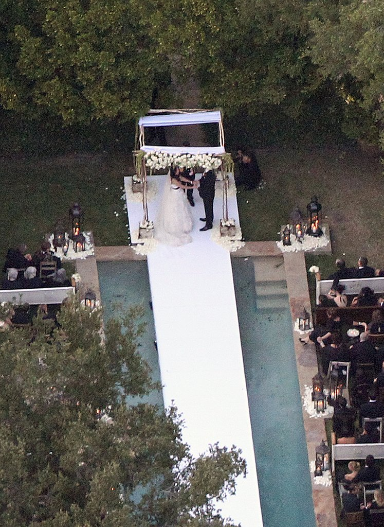 Guests sat on both sides of the pool.