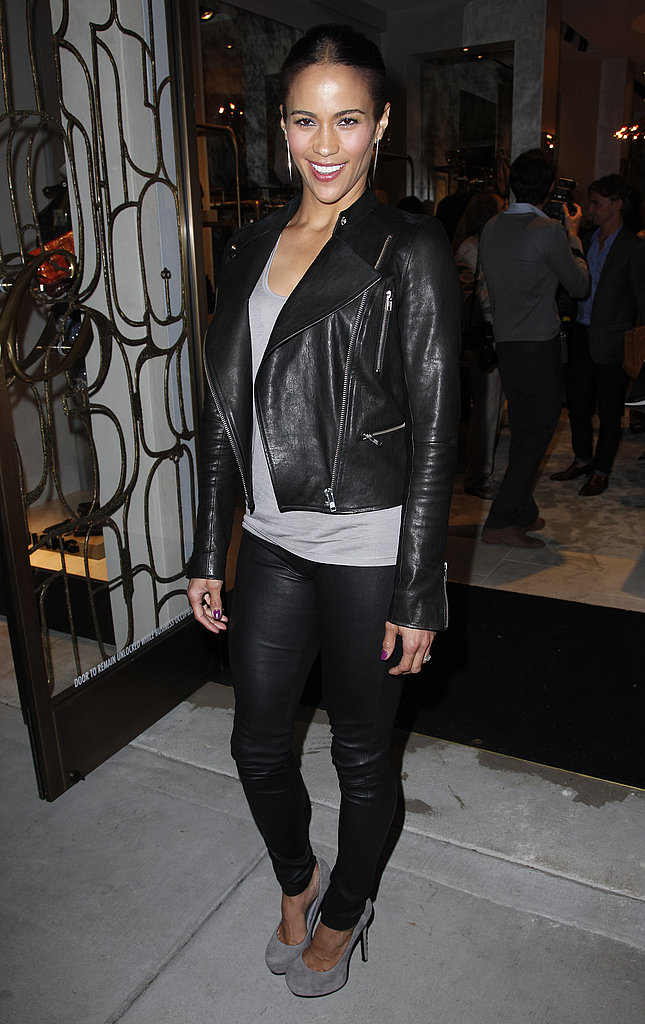 Paula Patton plays street style a little slicker in a motorcycle jacket and slim leather pants.