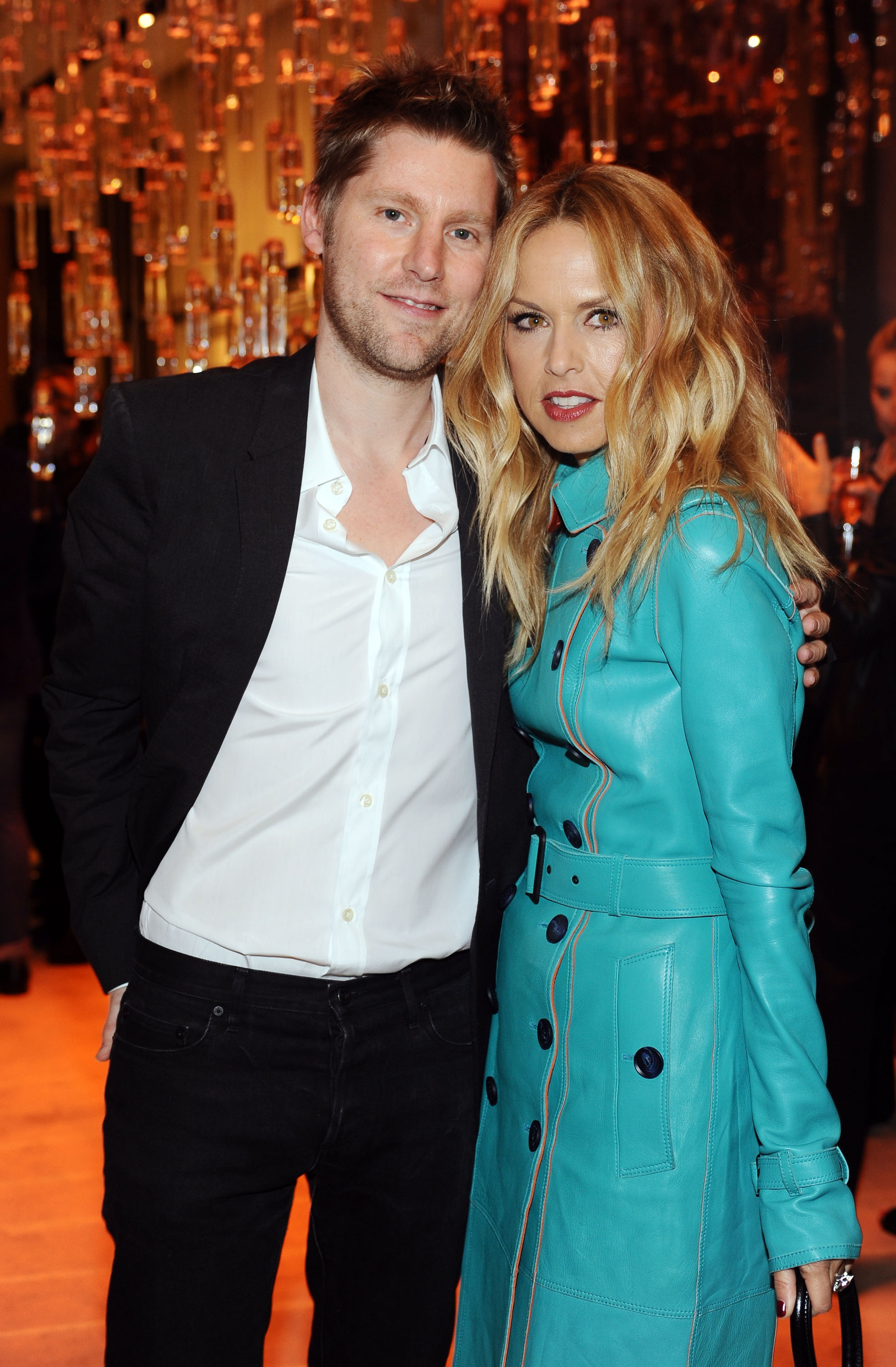 Rachel Zoe in a teal leather trench with Burberry's Christopher Bailey.