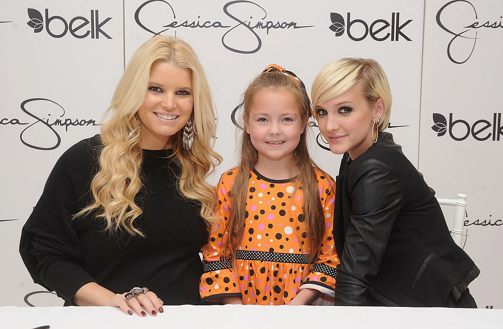 Jessica Simpson and Ashlee Simpson with a fan in Raleigh.
