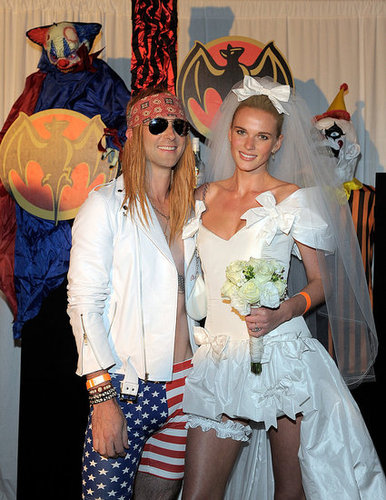 Adam Levine and Anne Vyalitsyna dressed as Axl Rose and Stephanie Seymour for Maroon 5's 2011 Halloween party.