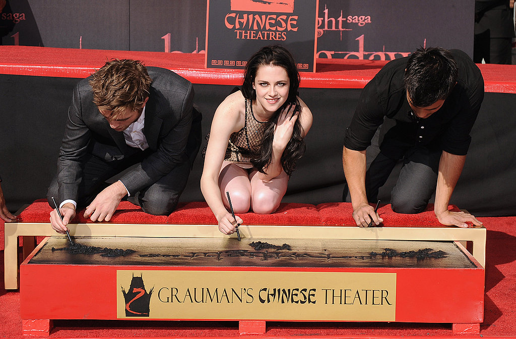 Kristen Stewart looked up from signing her plaque.
