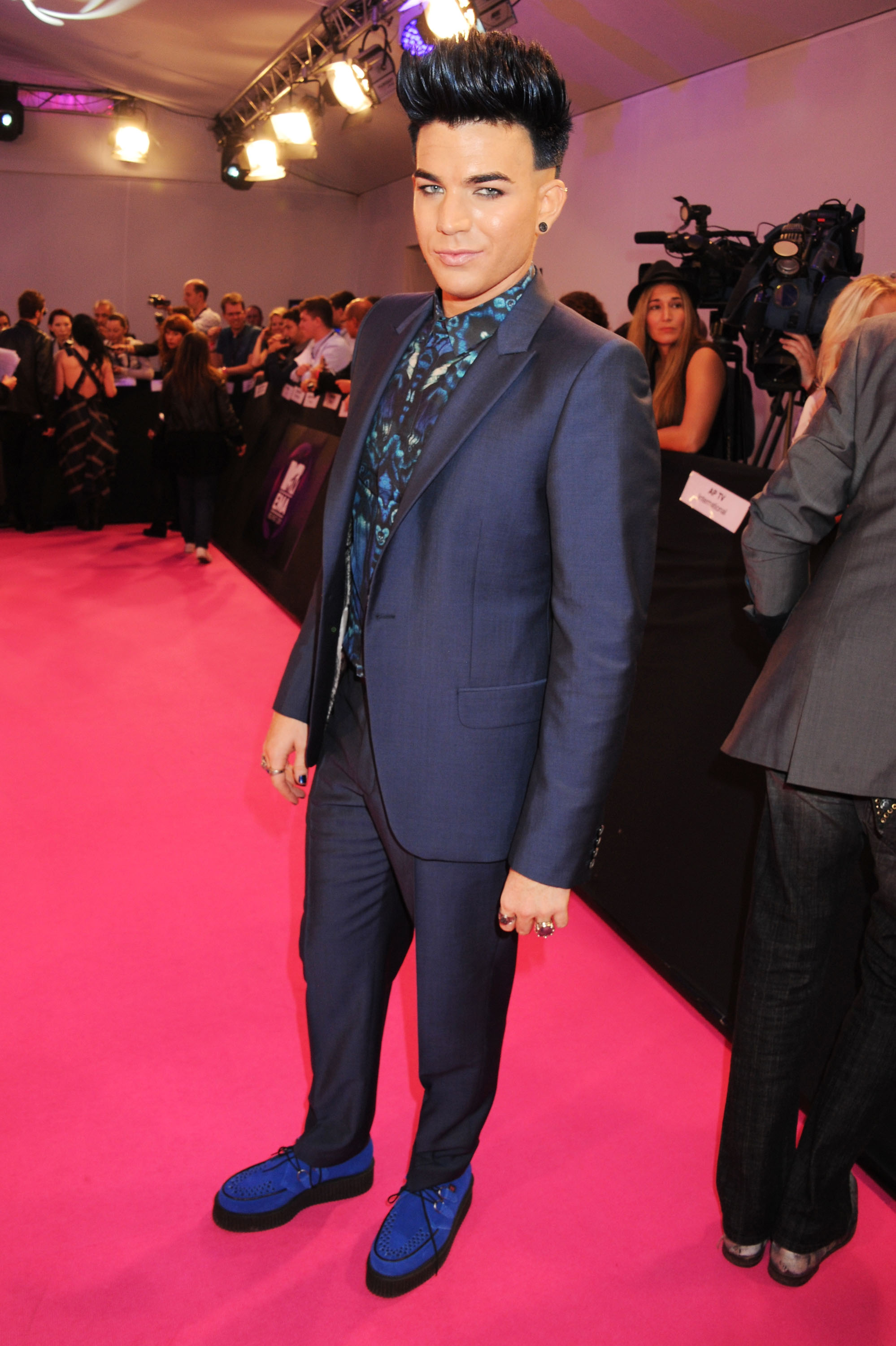 Adam Lambert's bright blue shoes stood out on the pink carpet.