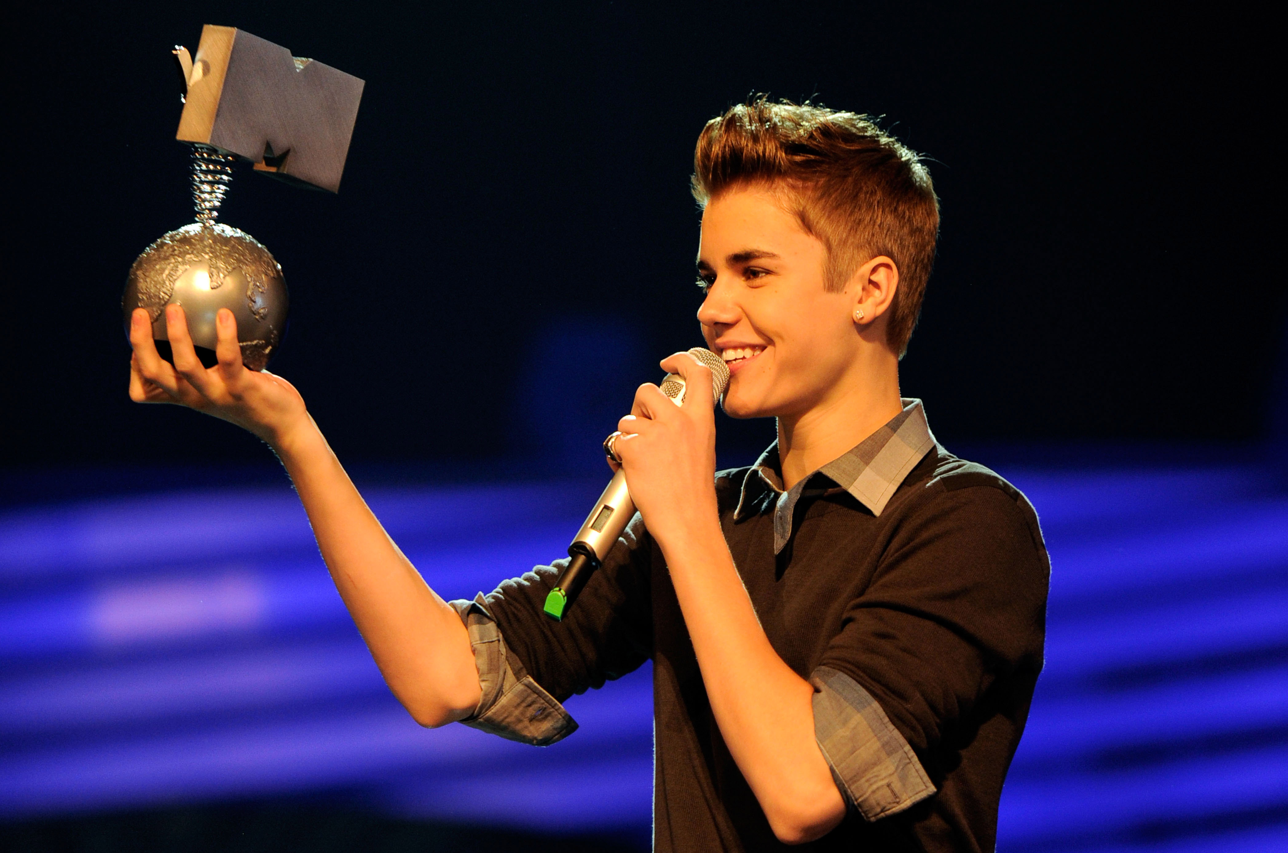 Justin Bieber held up his latest award.