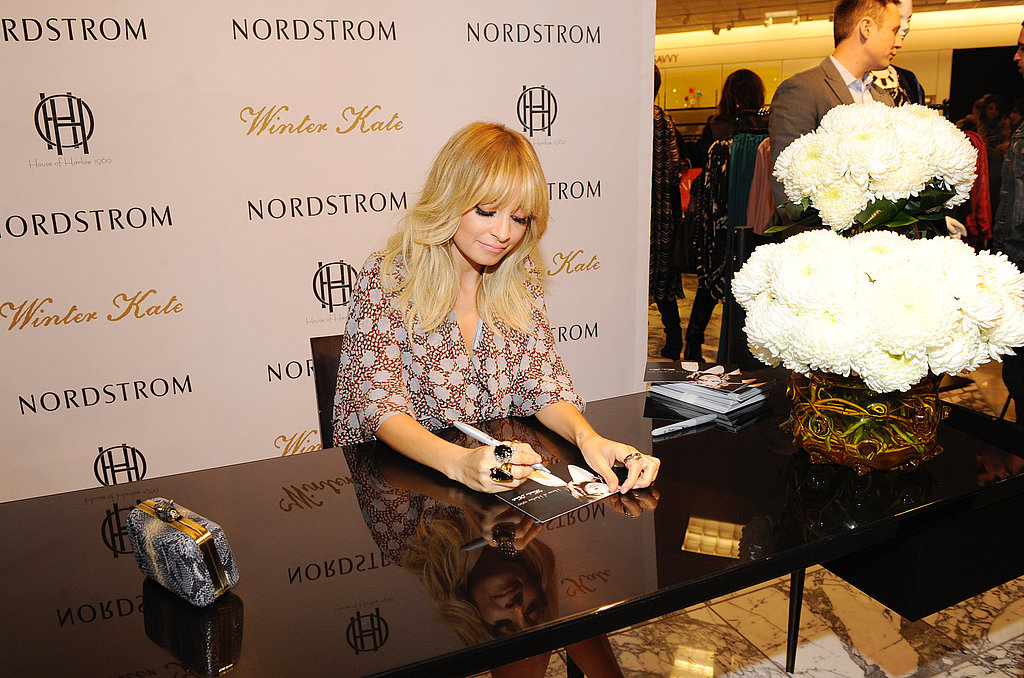 Nicole happily chatted with fans and signed autographs.