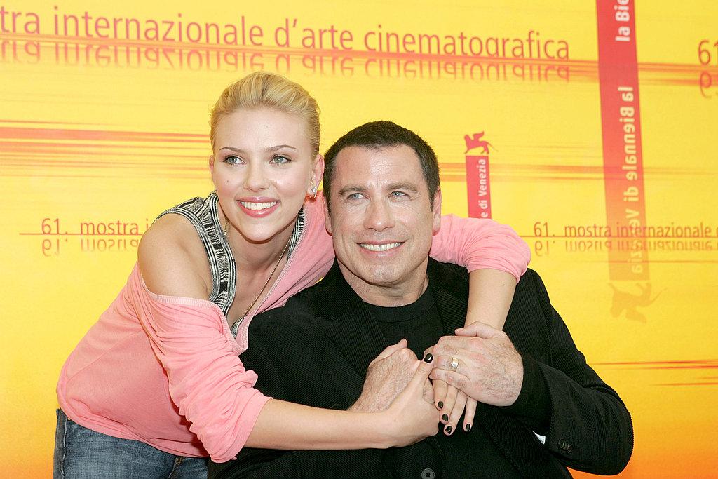 Scarlett gave John Travolta a big hug at the 2004 Venice Film Festival.