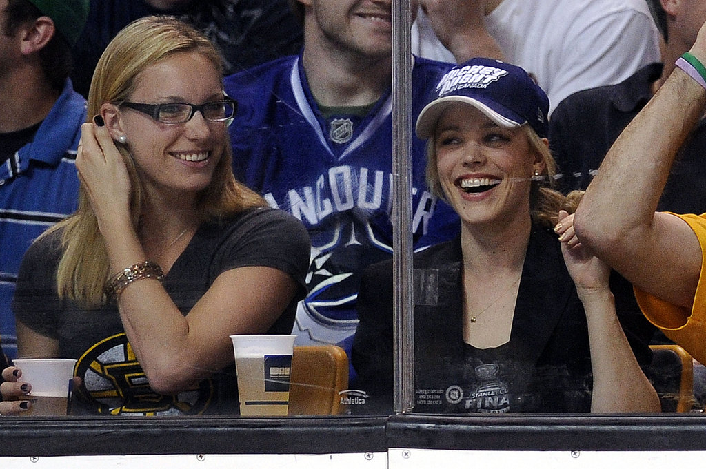 Rachel cheered and enjoyed a beer while watching the Vancouver Canucks in 2011.