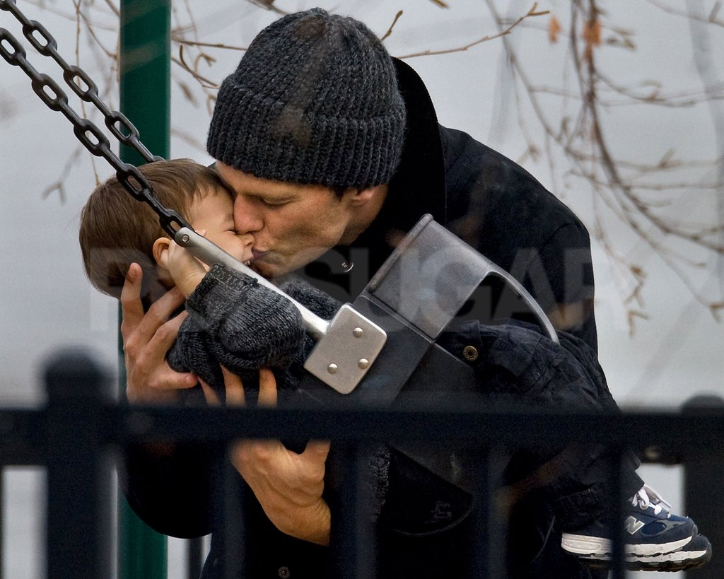 Benjamin Brady got a kiss from his dad, Tom, in a Boston park.