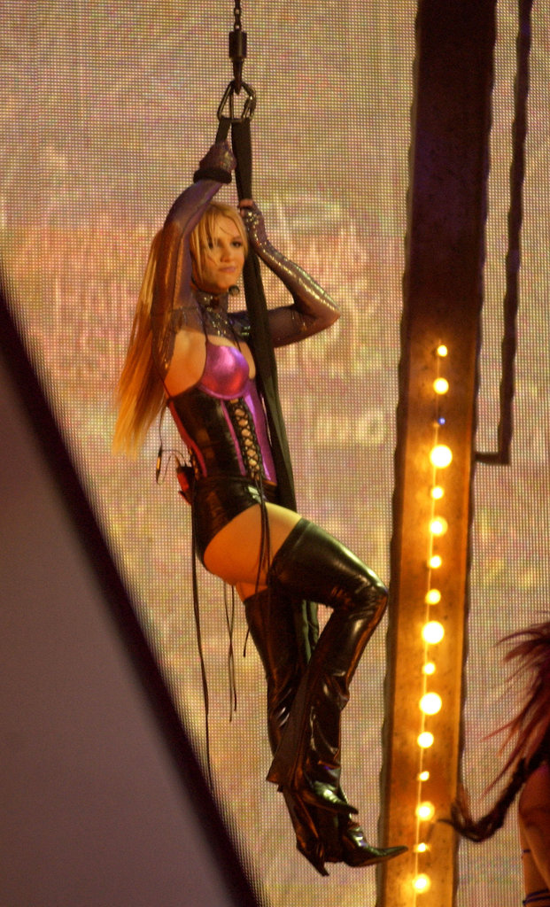 Britney hung from a harness at the 2003 American Music Awards in LA.