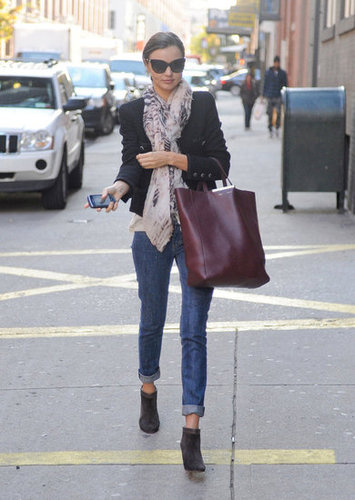A scarf is an easy way to amp up your day to day; then do like Miranda and swap out your flats for booties to really hit that street-chic edge.