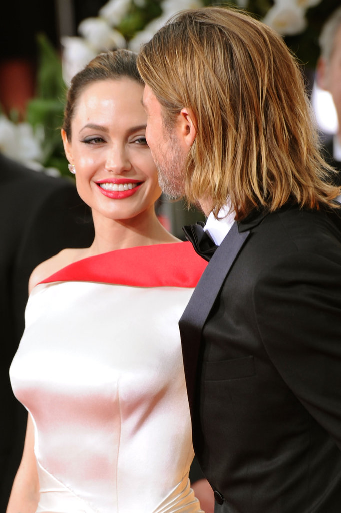 Angelina Jolie smiled at Brad Pitt on the red carpet.
