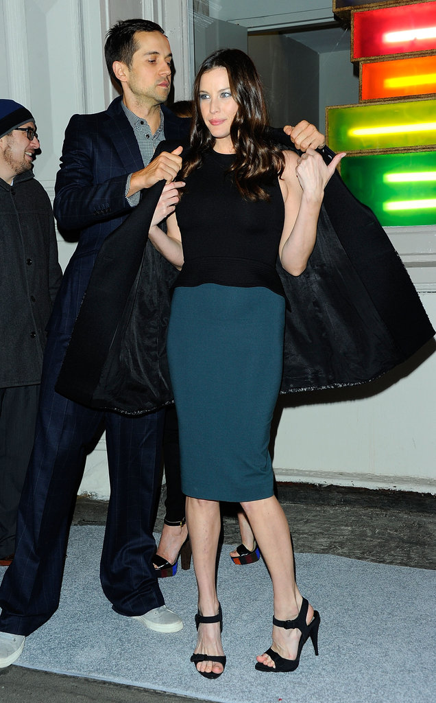 Liv Tyler wrapped her coat around her shoulders.