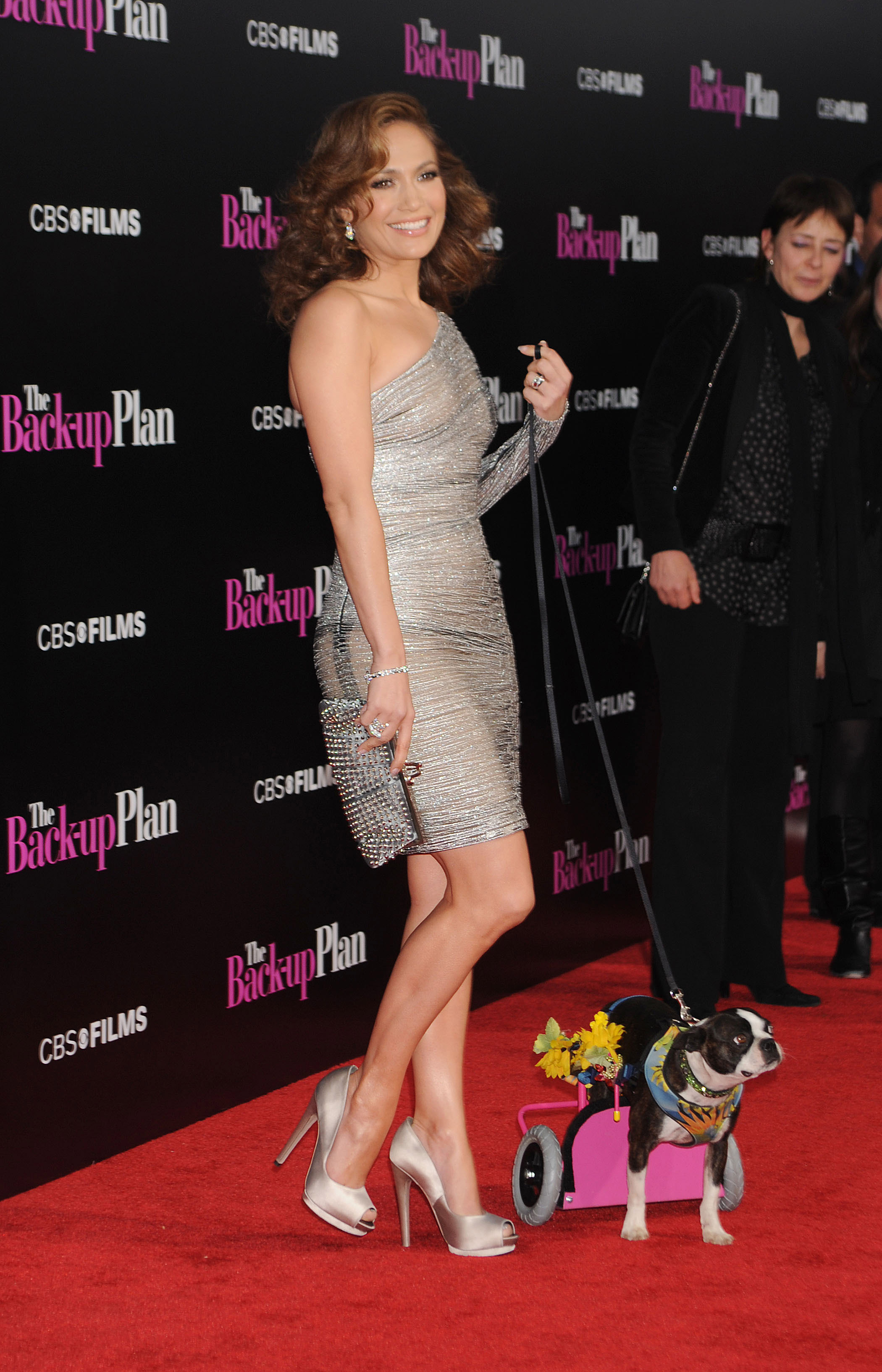 A stunning Jennifer Lopez and costar Nubbins do wheelies up the red carpet at the premiere for 2010's The Back-Up Plan.