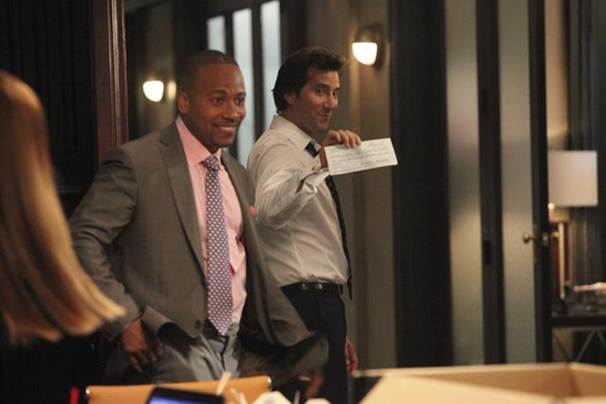 Columbus Short and Henry Ian Cusick in Scandal.
