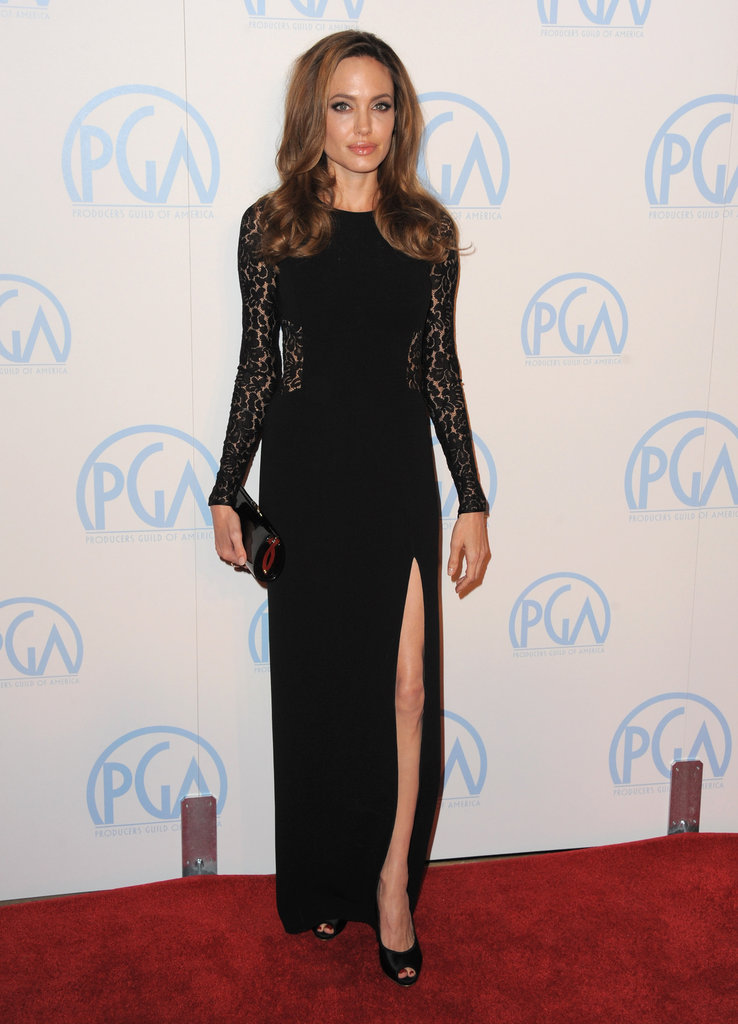 Angelina Jolie stunned in a black lace cutout Michael Kors gown. The thigh-high slit showed off her legs and peep-toe Ferragamo pumps.