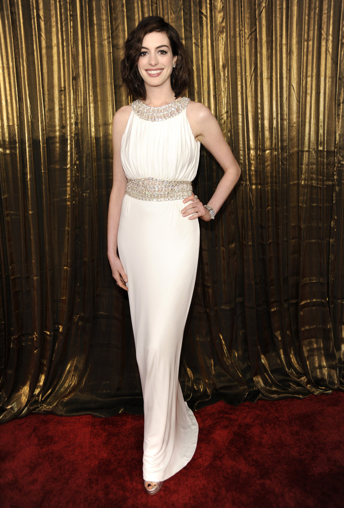 Anne Hathaway chose a white column Azzaro gown and Christian Louboutin pumps for the '09 awards.