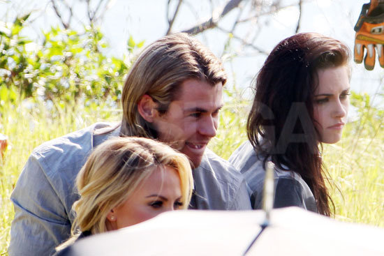Kristen wore her hair brushed to the side for one shot.