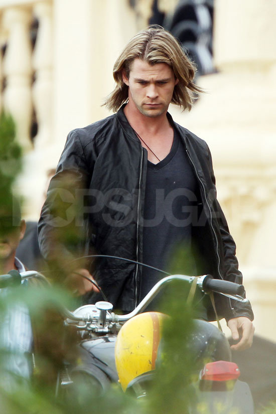 Chris posed alone with a motorcycle.