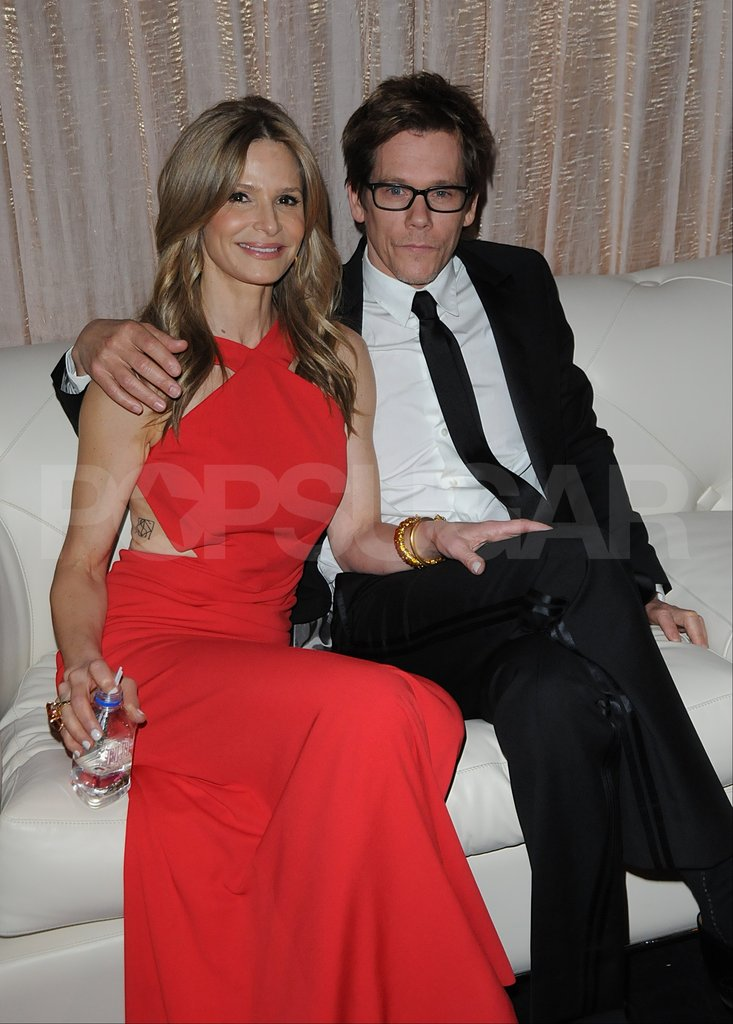 Kyra Sedgwick cozied up to husband Kevin Bacon in the SAG Awards  green room.