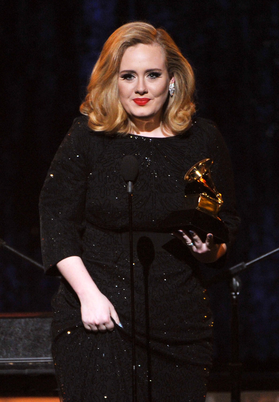 Adele accepted a Grammy award.