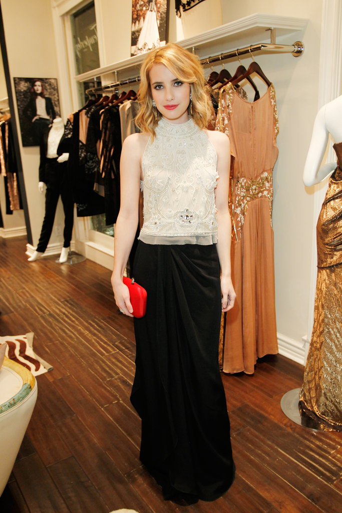 Just a month after, Emma showed off a more demure side of her style in an ivory and black number. To re-create this pretty look, just pair an ivory tank with a black maxi skirt, and finish off with a red box clutch and red lips.       Long Skirts by BCBG MAX AZRIASandals by Banana Republic