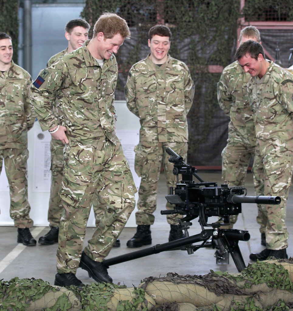 Prince Harry chatted with colleagues.
