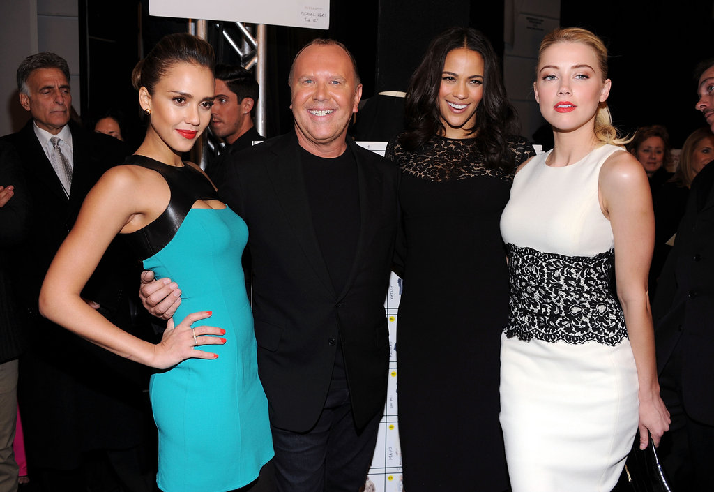 Jessica Alba, Paula Patton, and Amber Heard met up with Michael Kors backstage following his presentation.