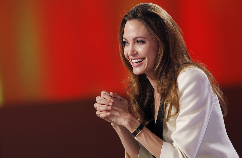 Angelina sat at a large desk with the French panel of hosts.