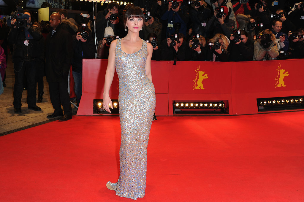Christina shined in a silver gown as she posed for the camera.