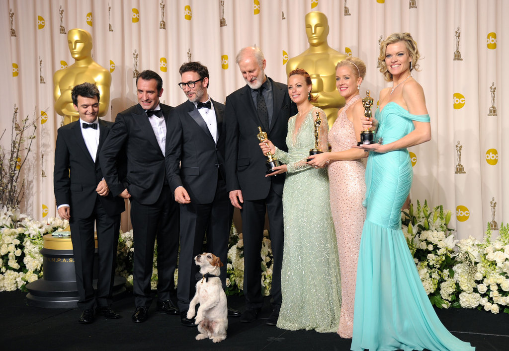 Uggie takes the stage in the press room with his award-winning castmates. Source: Getty