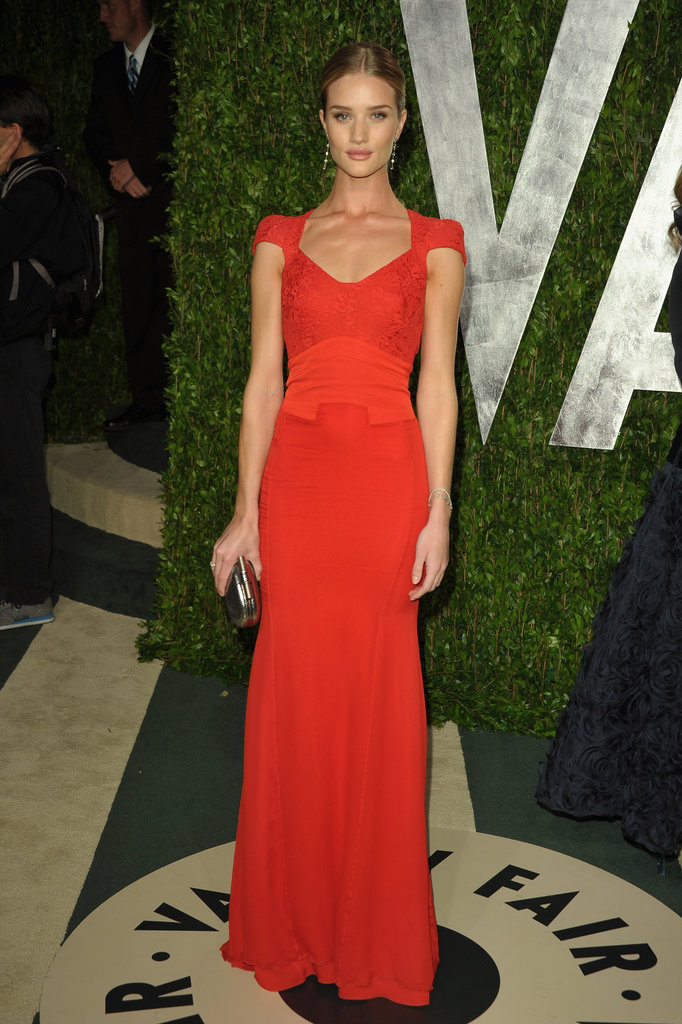 Rosie Huntington-Whiteley in a red cap-sleeve Antonio Berardi gown.