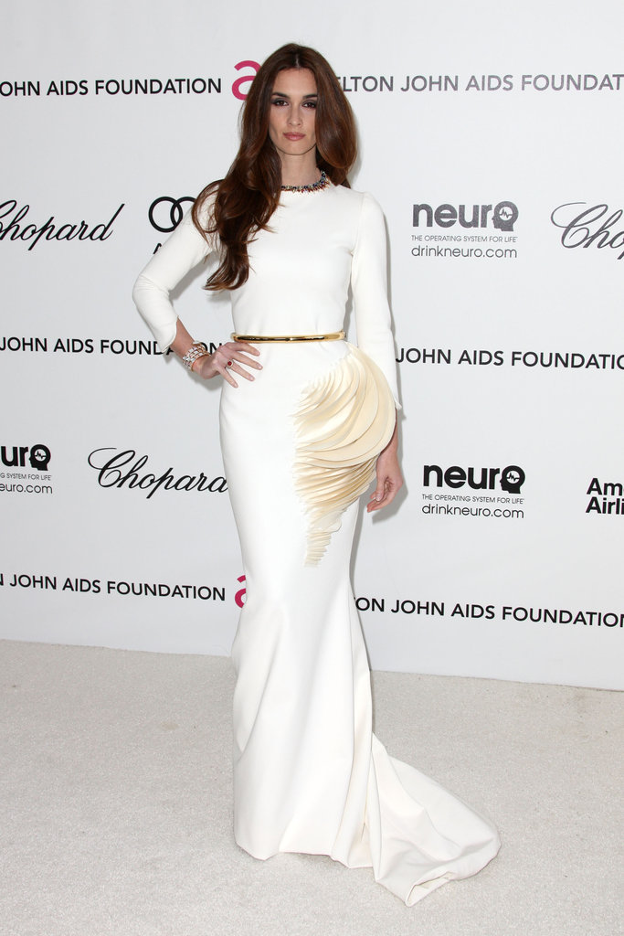 Paz Vega kept it ultra-sleek in a long-sleeved white gown with an eye-catching feather detail at the waist.