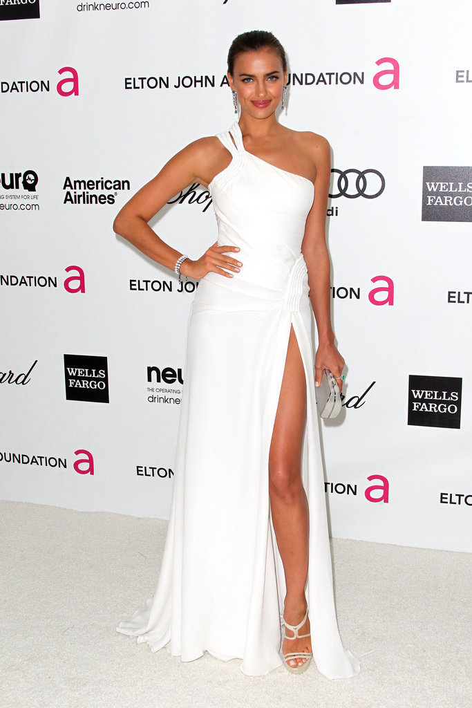 Irina Shayk showed off her legs in a white-hot slit Versace gown.