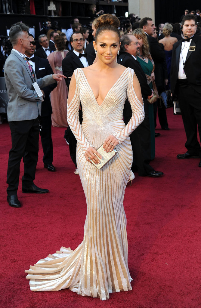 Jennifer Lopez turned up the sexy on the red carpet with a serious dose of sultry from Zuhair Murad. Notice the low neckline — and backline — and revealing arm cutouts, not to mention sheer insets throughout the whole of the design.
