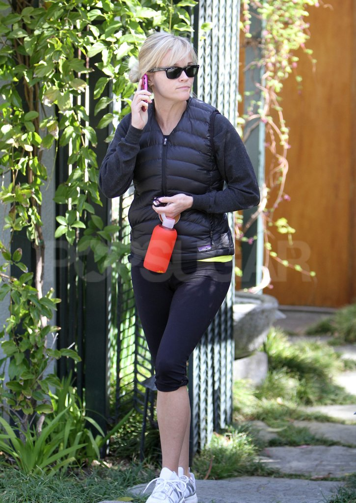 Reese Witherspoon chatted on her cell phone.