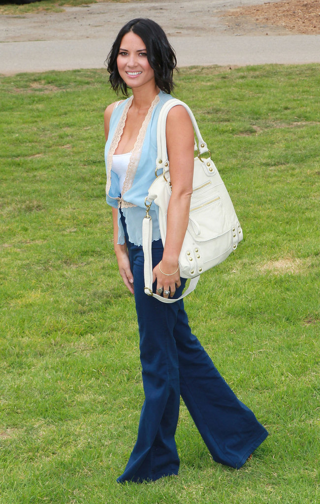 Olivia Munn was the picture of Spring style in a pair of casual flares and a lace-trimmed blouse.