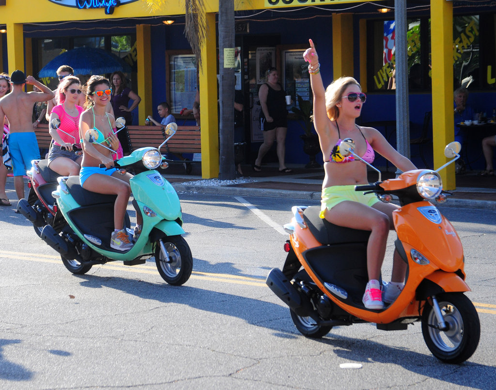 The girls rode bright scooters.