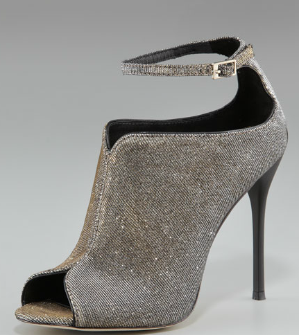 Dress up your Summer LBD with these sparkle-infused ankle-strap booties — we're guessing they'll make your legs look miles long. B Brian Atwood sparkly ankle-strap booties ($350)