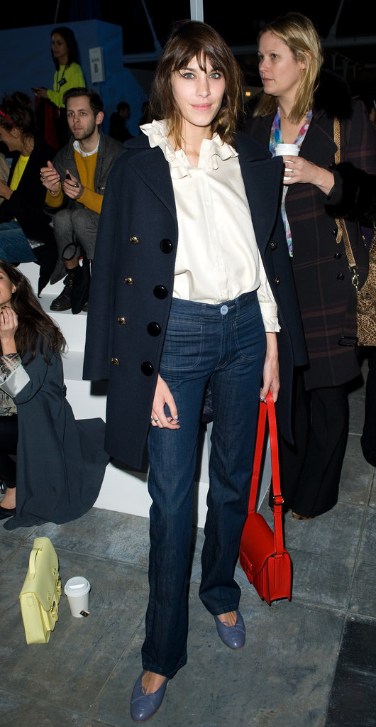 Alexa Chung finished a ladylike blouse with a pair of subtly-flared jeans.
