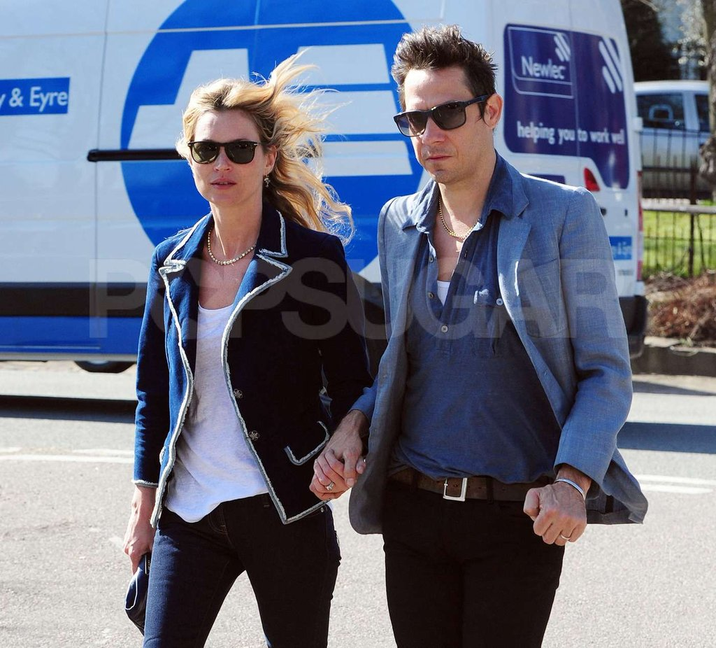 Kate Moss and Jamie Hince hold hands on a walk in London.