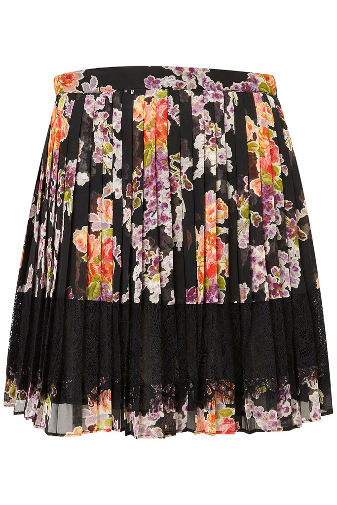 This pretty option would transition seamlessly day to night, Spring to Fall.  Topshop Floral Lace Pleat Skirt ($76)