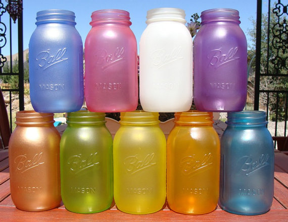 Set the mood with Custom Color Mason Jars ($70 for 12). Choose your favorite color and use the jars as vases or candles.
